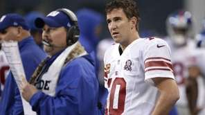 New York Giants quarterback Eli Manning (10) watches