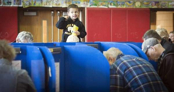 Long Beach resident Luke, 4, sits on his