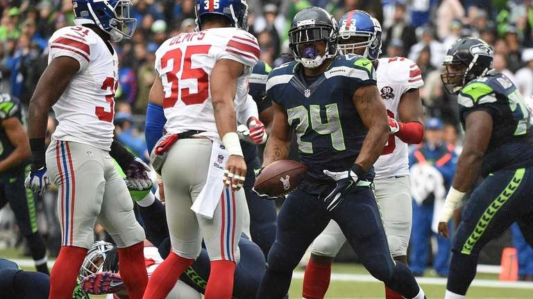 Seattle Seahawks running back Marshawn Lynch scores a
