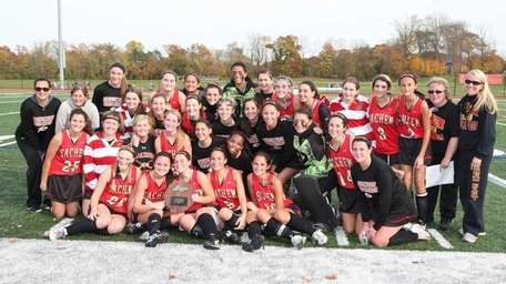 Sachem East poses with the championship trophy after