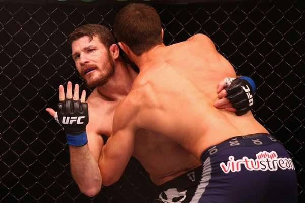 Michael Bisping appeals to the referee after being