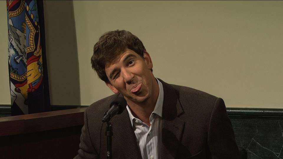 Eli Manning makes a silly face during a