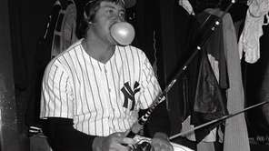 "Yankees pitcher Jim ""Catfish"" Hunter blows a bubble"