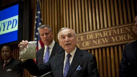 New York Police Commissioner Bill Bratton holds up