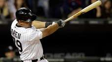 The Chicago White Sox's Jose Abreu hits a