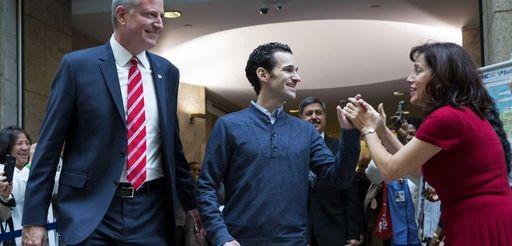 Dr. Craig Spencer walks with Mayor Bill de
