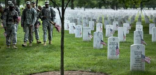 Soldiers arrive to plant flags at graves in