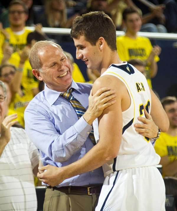 Michigan head coach John Beilein congratulates guard Austin