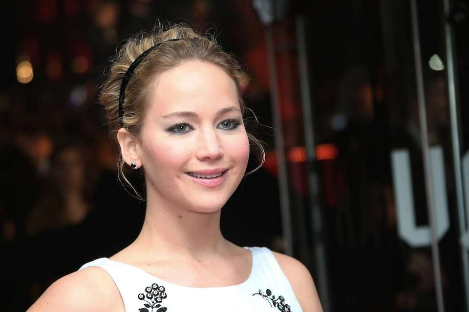 Jennifer Lawrence poses for photographers upon arrival to