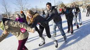 Friends form a train as they ice skate