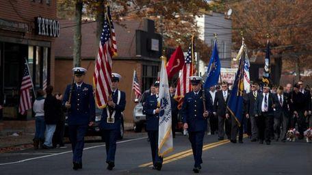 Members of the U.S. Coast Guard lead the