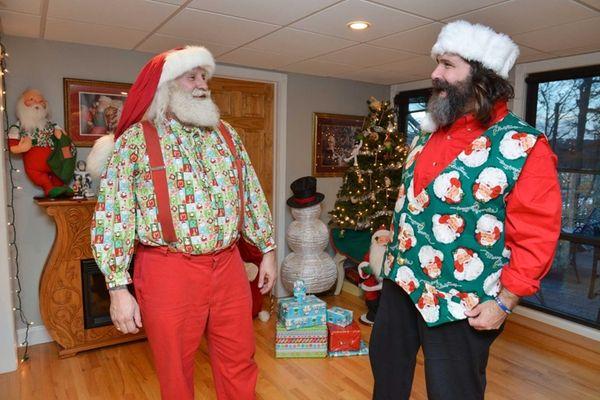 Santa Ambassador Mick Foley, right, and Santa Claus
