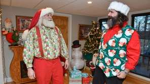 Santa Ambassador Mick Foley, right, and Santa Claus