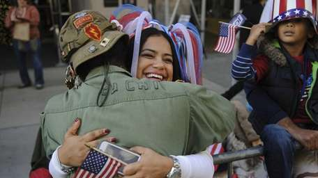 Vietnam veteran Laurence Lynch hugs Kelly Sosa during