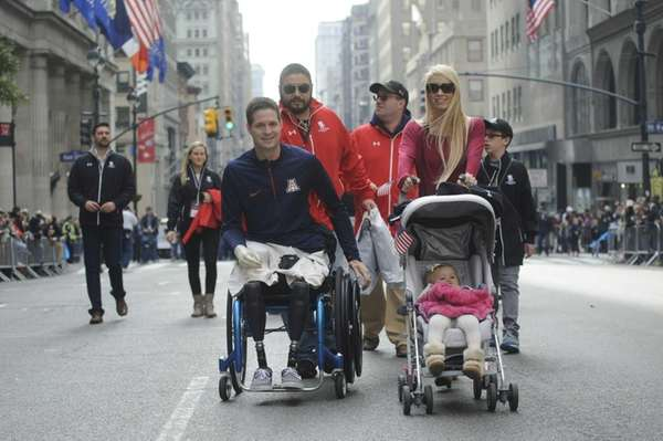 Iraq veteran and triple amputee Brian Kolface, left,