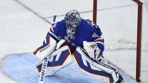 New York Rangers goalie Henrik Lundqvist protects the