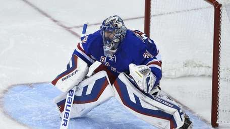 New York Rangers goalie Henrik Lundqvist protects the