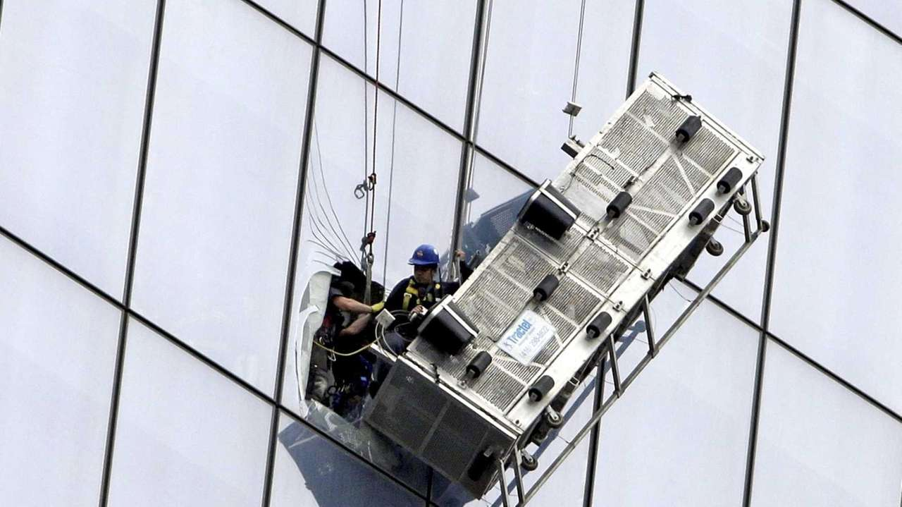 FDNY members rescue two window washers after their