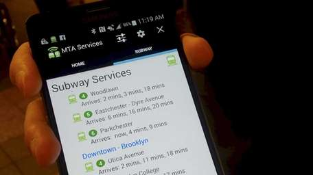 MTA officials displaying a developer's app that would