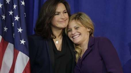 Actress Mariska Hargitay, left, hugs rape victim and