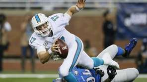 Miami Dolphins quarterback Ryan Tannehill is sacked by
