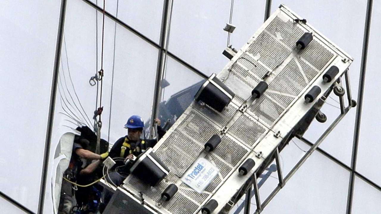 A window washer is seen being rescued by