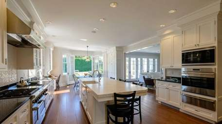 This newly built, seven-bedroom home in Water Mill,