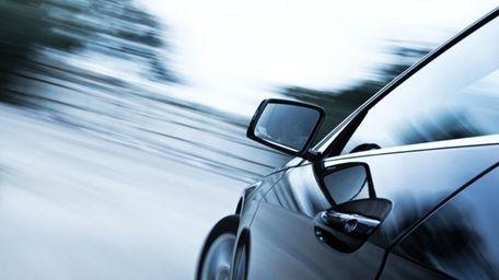 Car driving along a road.