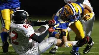 Patrick Walsh of the Syosset Braves tackles Billy