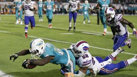 Miami Dolphins wide receiver Jarvis Landry stretches out