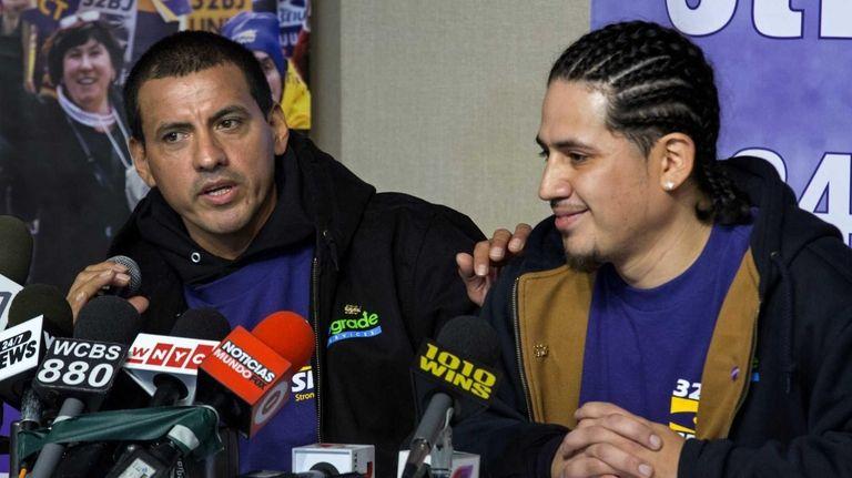Juan Lizama, left, and Juan Lopez, window washers