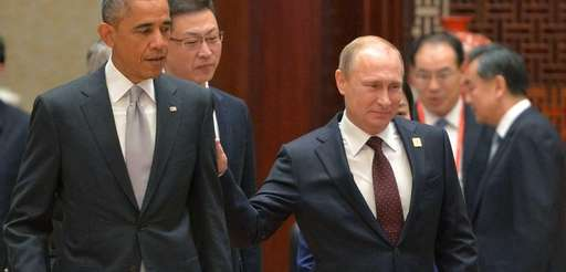 Russian President Vladimir Putin walks near U.S. President