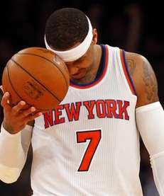 Carmelo Anthony reacts after losing a game at