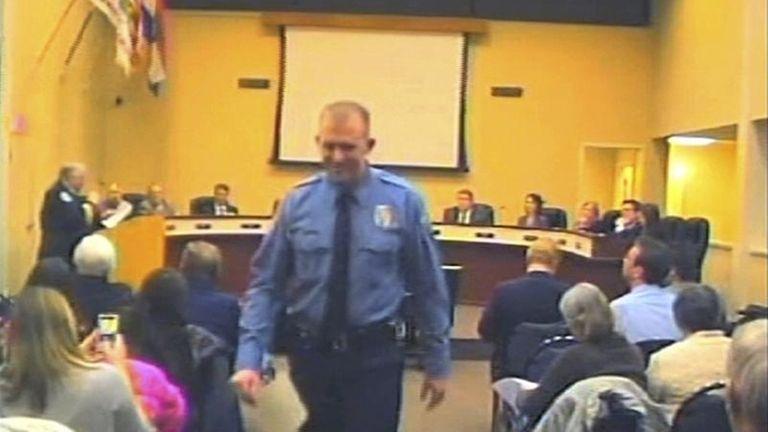 Officer Darren Wilson attends a city council meeting