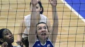 Glenn's Alexis Groark looks to block in the