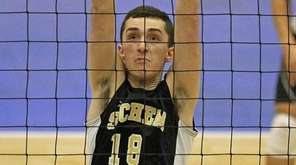 Sachem North's Adam Bloomfield goes for the block