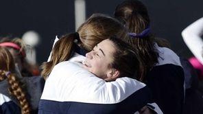 Massapequa's Hope Breslin, right, hugs a teammate after