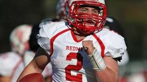 East Islip's Jack Hannigan rushes for a big