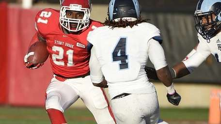 Stony Brook running back Stacey Bedell rushes the