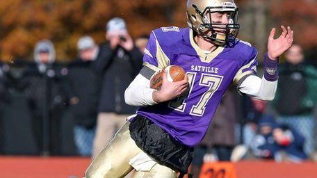 Sayville's Jack Coan takes the ball upfield in