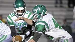 Seaford's Andrew Cain hands off to Frank Lauretti