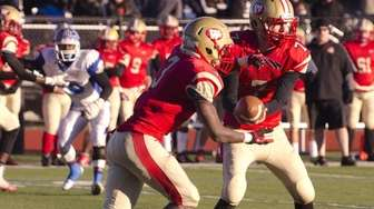 Half Hollow Hills West's Anthony Lucarelli hands the