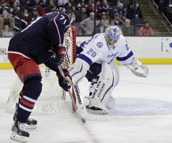 Tampa Bay Lightning's Evgeni Nabokov, right, of Kazakhstan,