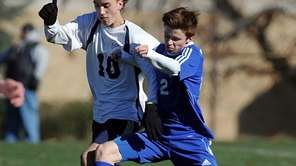 Mattituck's Mike O'Rourke, right, challenges for the ball