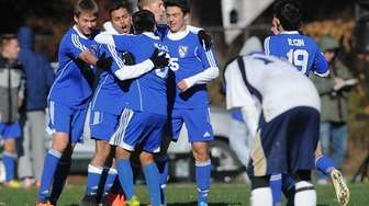 Mattituck players celebrate their third goal in an