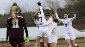 Port Jefferson's Jillian Colucci is hugged by teammate