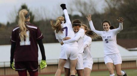 Port Jefferson's Jillian Colucci is hugged by teammate