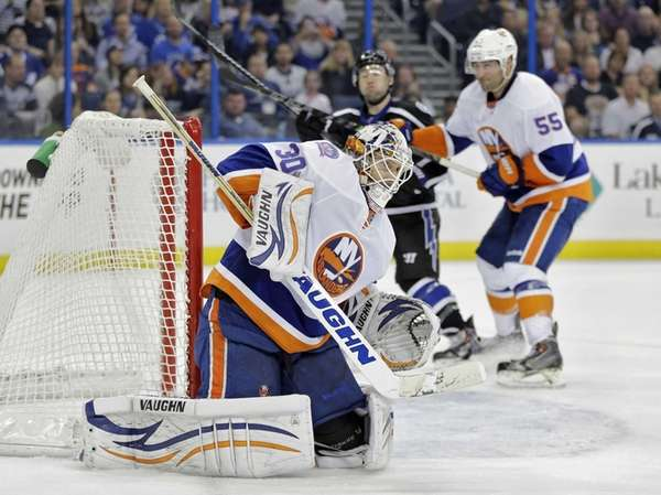 New York Islanders goalie Chad Johnson makes a