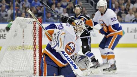 New York Islanders goalie Chad Johnson makes a