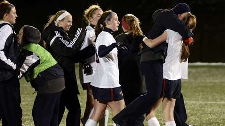 South Side celebrates after defeating Pittsford-Mendon in an